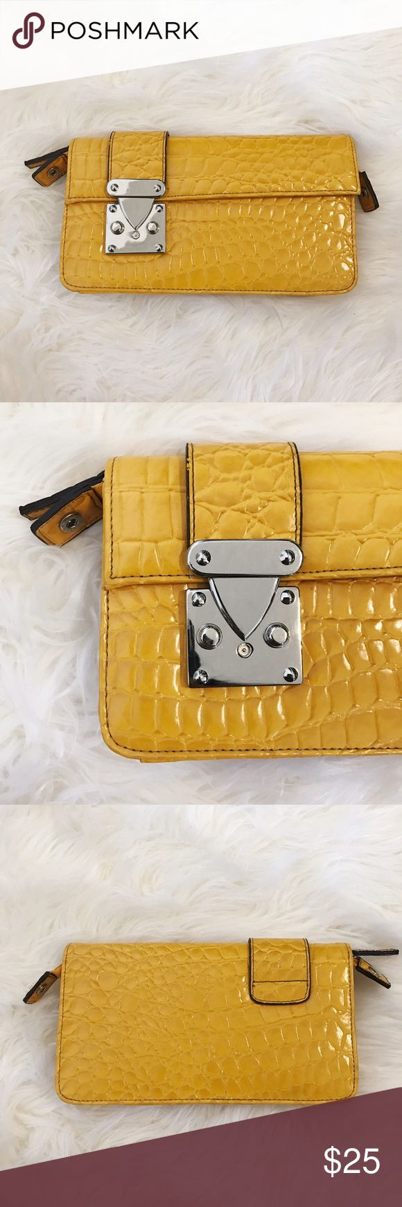 Golden Textured Bag Golden yellow clutch bag with crocodile pattern. Glossy texture. Very good for going out during the day. Definitely a statement piece with it's bright color! (Not UO) Urban Outfitters Bags Clutches & Wristlets