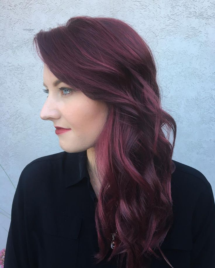This romantic dark violet with warm red tones is a fun, dramatic hair color option for fall. Aveda color by stylist Phillip Procopio.