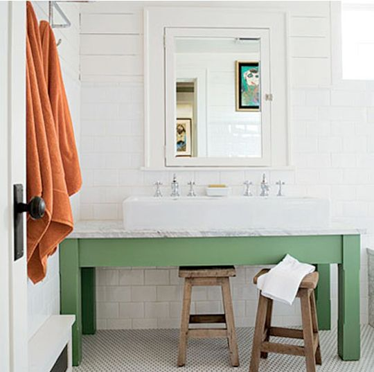 white bath with accents of green and orange.  love the marble and the trough style sink.