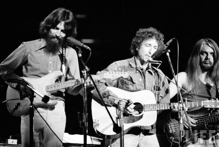 Leon Russell backing Bob Dylan on.....bass? Ringo on tambourine? What a time to be a music fan. The Concert For Bangladesh...the original all-star concert fundraiser, thanks to George Harrison (seen here smiling, 'cuz he's happy Dylan actually came out on stage)!