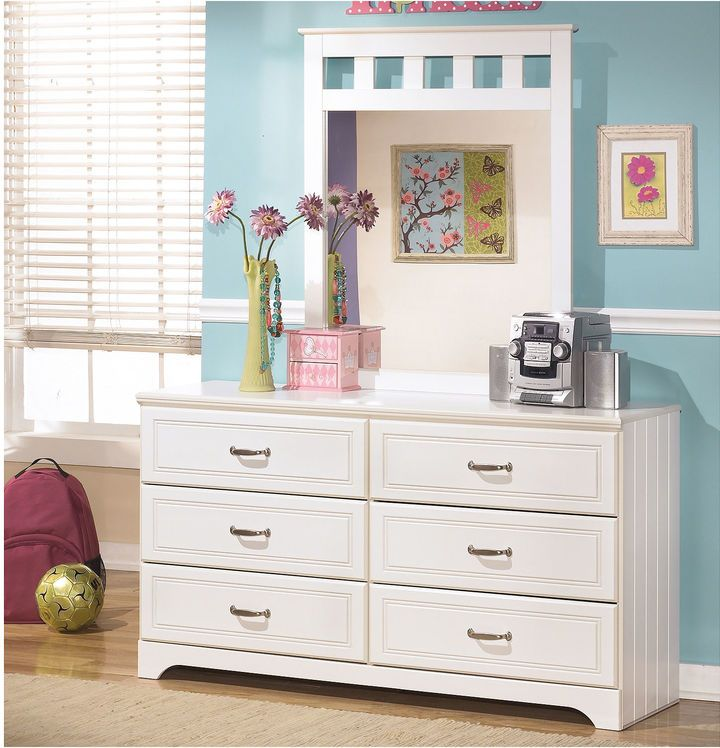 You'll love the airy cottage design of our Lulu dresser with mirror, featuring beautiful grooved panels and embossed framing. MDF/glass construction vinyl finish butt joinery 6 smooth-operating drawers metal glides nickel-tone hardware 57x18x70H wipe clean Assembled in the United States with global components Signature Design by Ashley is a registered trademark of Ashley Furniture Industries, Inc.