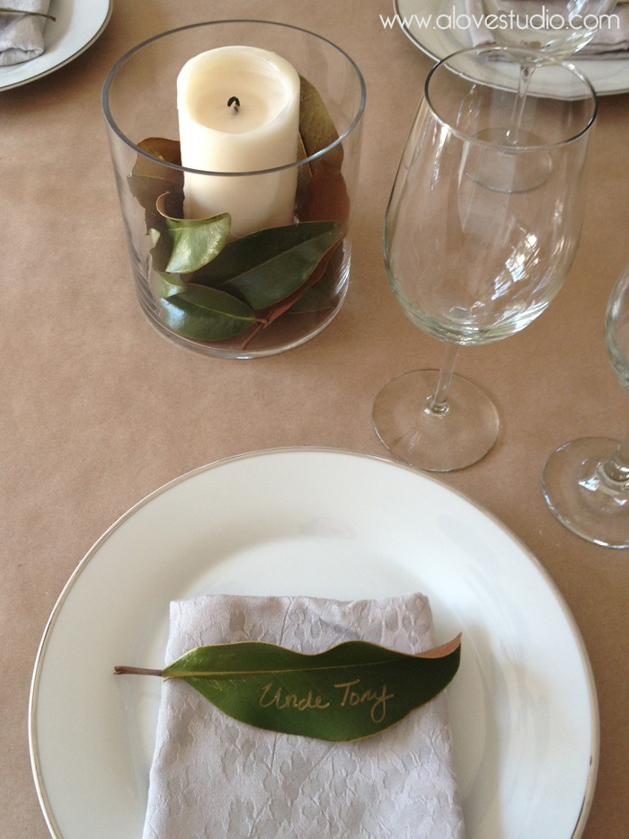 simple place setting place cards, gold sharpie name on magnolia leaves for an easy thanksgiving table idea