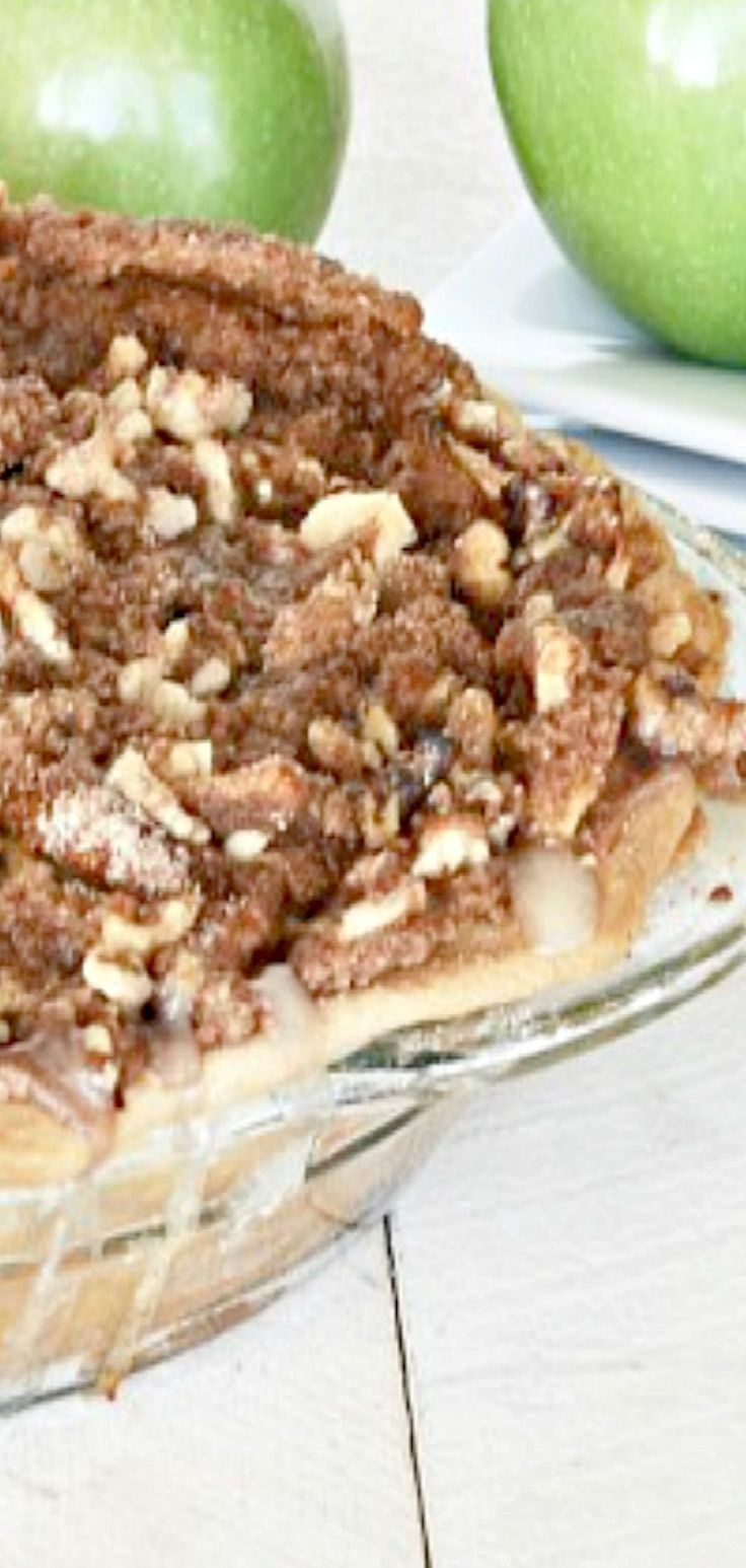 Sour Cream Apple Pie--this is a recipe I've made for over 20 years and has always been a family favorite! Tender apples enrobed in a delicious, creamy sour cream sauce.then topped with a brown sugar walnut crumb topping. WOW!!!