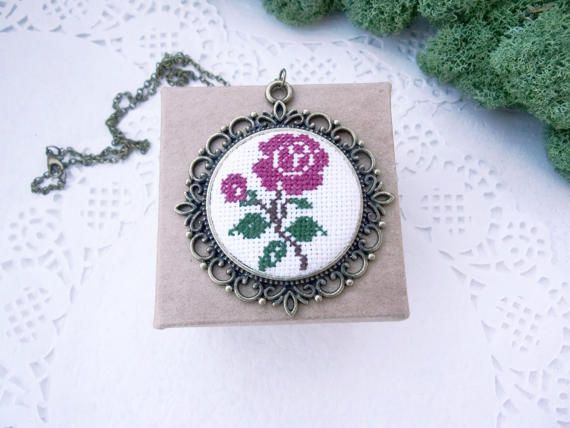 Violet Rose - Cross stitch embroidery necklace The embroidery is made on white canvas. For the base is used antique bronze pendant. - Size of the pendant: d= 2 inch / 5,2 cm - Size of the embroidery: d=1,38 inch / 3,5 cm - Preferred chain length could be selected from the drop down menu. - Default length we are sending is 20/ 50 cm  _________  ** Embroidery necklaces will be MADE TO ORDER, so please allow 3-5 days before shipping. ** There might be a slight change fro...