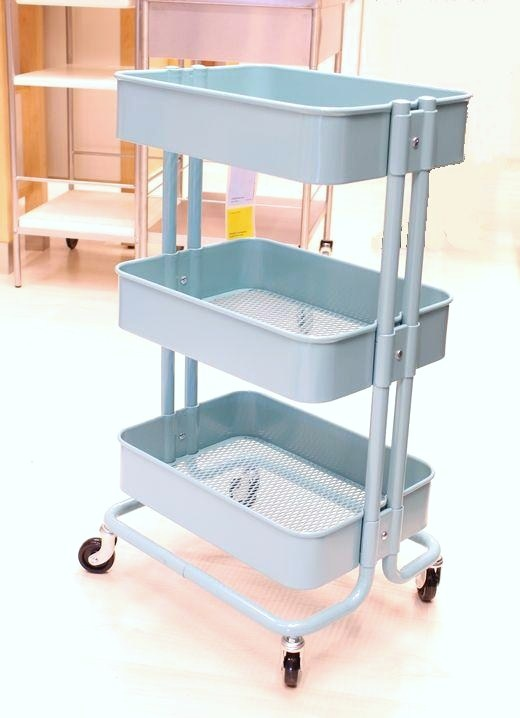 Kitchen trolley, Ikea.  great for craft supplies, kids stuff, etc. roll it into closet after done. love it