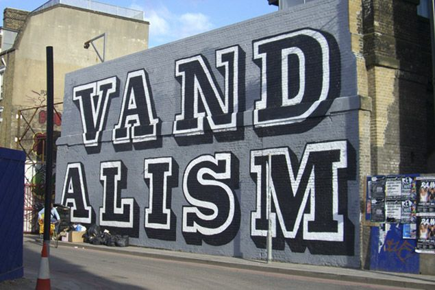 'Vandalism'  •  Ben Eine  •  Spray paint on brick  •  Holywell Lane, London