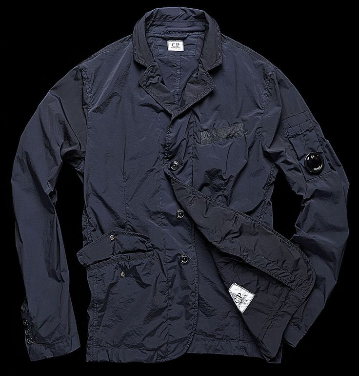 Reflective nylon/pocket/closure with C.P. Company personalised buttons/ front buttoned pockets/cuffs with three C.P. Company personalised buttons.