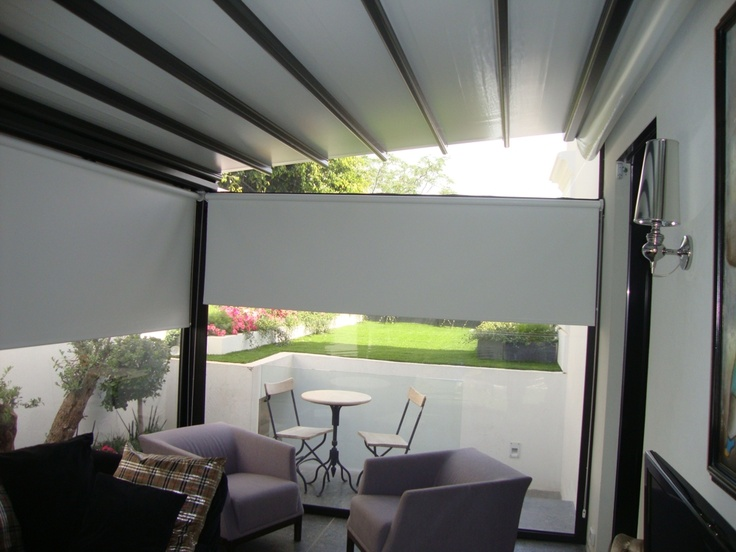 Pergole Unica 130, pergole retractabile Gibus cu structura aluminiu pentru terase case si vile. Foto pergola terasa casa, inchidere cu pereti transparenti de vant.Interior.
