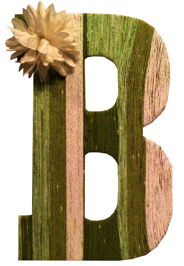 wooden letters covered in yarn 1x10' board, length cut to fit your wall water-based paint, in desired color 2  paintbrush kraft paper pen raffia-wrapped floral wire wire cutters scissors skein of .