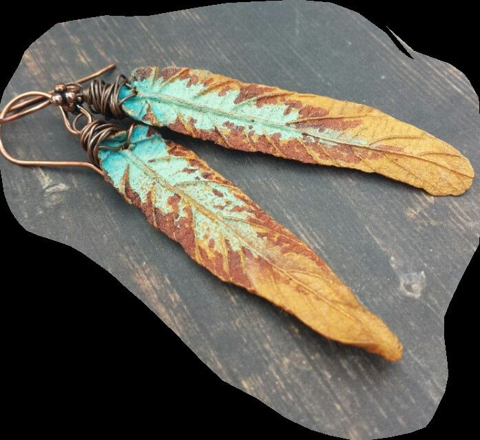 November 15 Entry. Polymer clay leaves by Helen Backhouse simply copper wrapped.