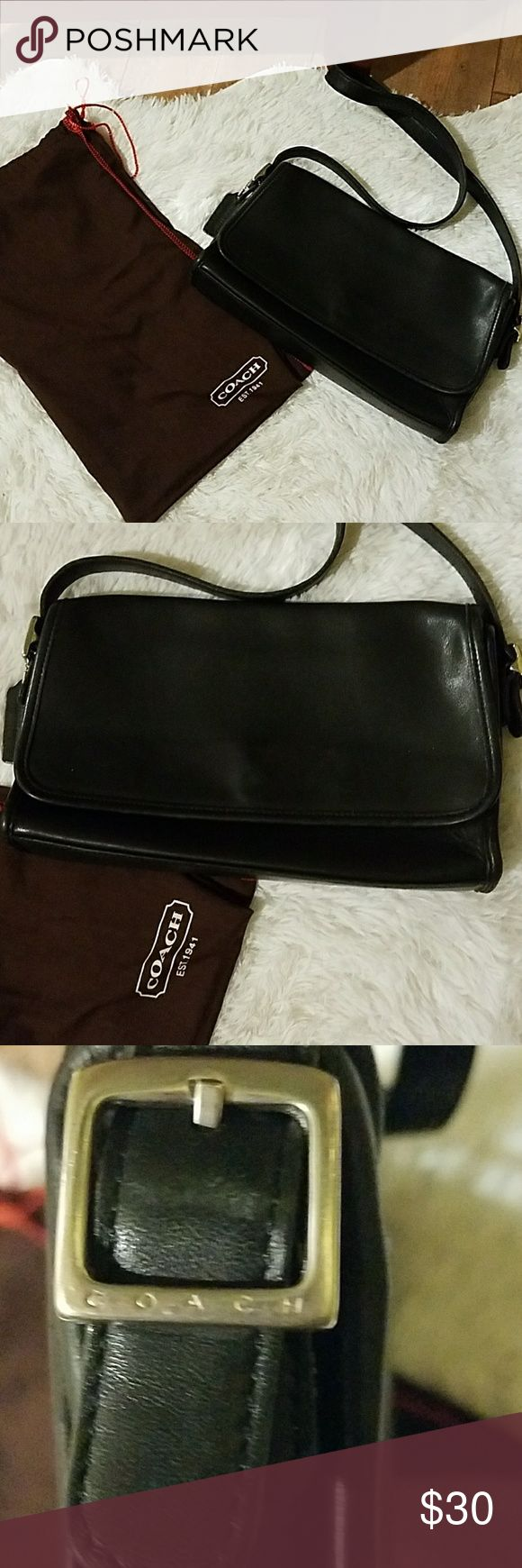 Coach purse with dust bag This vintage black coach bag is in good condition the hardware is Silver the coach tag is attached, this purse has  one outer compartment in the back and one packet with the zipper in the inside , small signs of wear to the corners and inside, the purse has some scratches very light , the purse also comes with a coach dust bag. Coach Bags Shoulder Bags