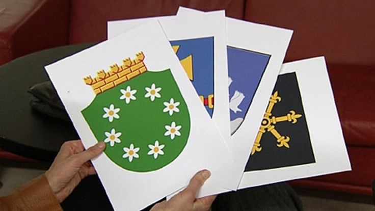 Kuvat neljästä uudesta vaakunasta. Päällimmäisenä Raaseporin kiistely vaakuna, seuraavina Kauhavan, Siikalatvan ja Kouvolan uudet vaakunat.