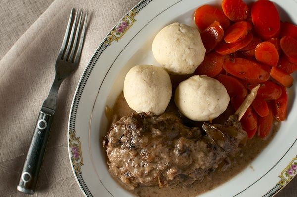 A classic hasenpfeffer recipe, a German dish of marinated and braised hare or rabbit, served with traditional German semolina dumplings.