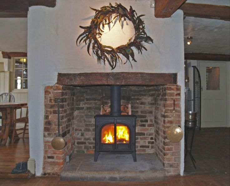 Double sided Stovax Stockton 8 installed into the Bear pub Stock Essex by Scarlett @ Design a fireplace 2010