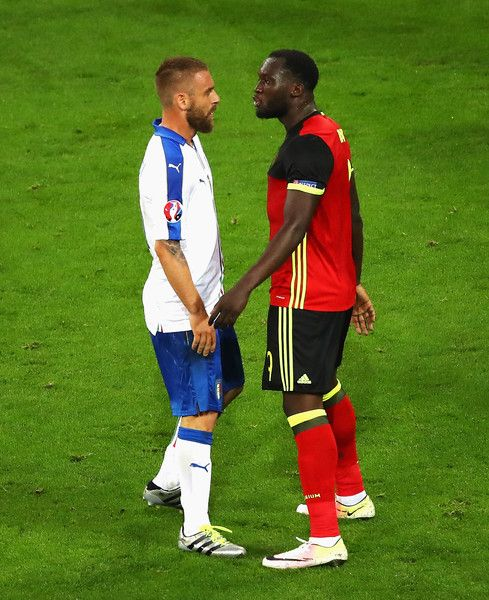 Romelu Lukaku of Belgium and Daniele De Rossi of Italy face off during the UEFA EURO 2016 Group E match between Belgium and Italy at Stade des Lumieres on June 13, 2016 in Lyon, France.