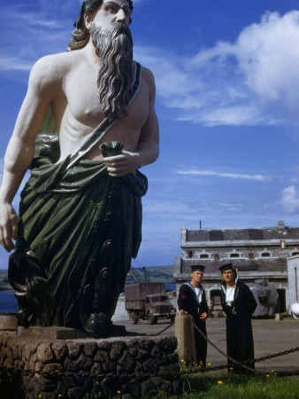 Two Sailors Look at a Figurehead Saved from an Old Ship