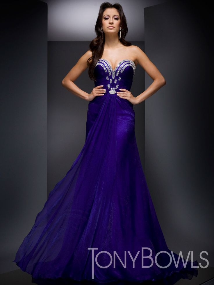 Sweetheart strapless gown with rows of crystal detailing on neckline and center front of bodice, gathered front drape and skirt with flaired hem.  Tony Bowls.