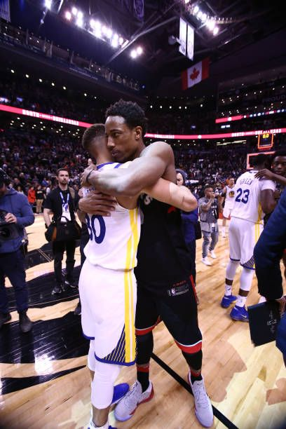 DeMar DeRozan of the Toronto Raptors hugs Stephen Curry of the Golden State  Warriors after the game on January 13 2018 at the Air Canada Centre in. 2892ebee2