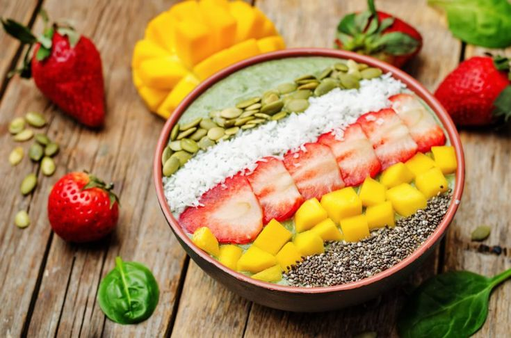 Spinach smoothie bowl with strawberries, coconut, mango, pumpkin seeds and seeds Chia. toning. selective focus