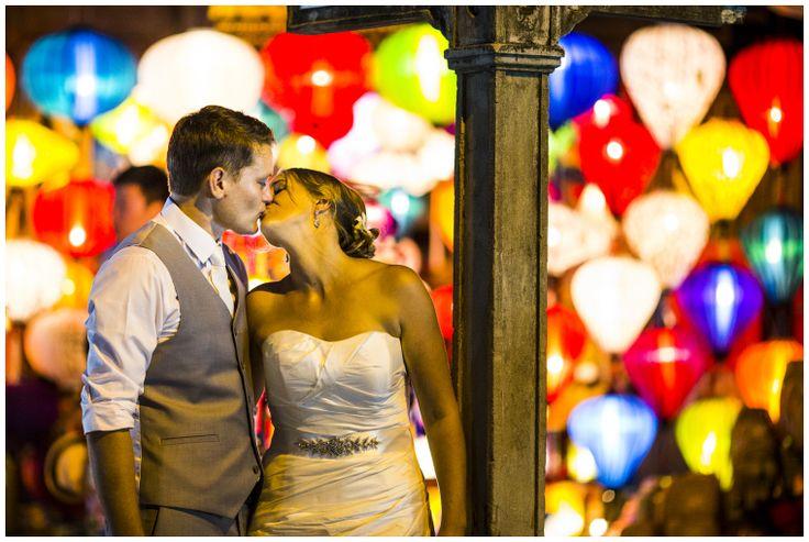 The happy couple in Hoi An Ancient town beautifully lit by silk lanterns. Photo courtesy of Aaron Joel Santos. #HoiAnEventsWeddings #HoiAn #VietnamBeachWeddings