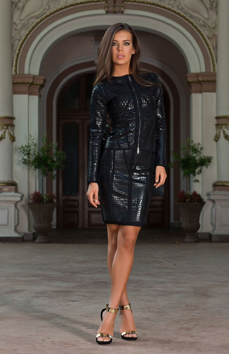 The Alvada black bodycon skirt suit has a classic tailored design with faux crocodile and panel detailing. Shop the collection online at Vero Milano now. http://www.veromilano.com/shop/best-sellers/dresses/alvada/