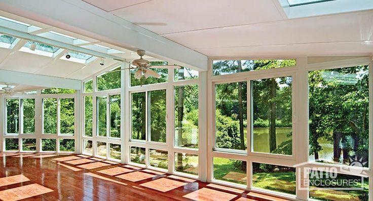 White vinyl four season sunroom with glass roof panels