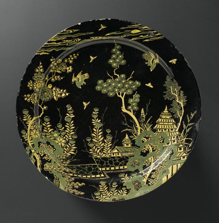Earthenware plate with a black ground and Chinese landscape in yellow and green: Dutch, Delft, 17th century