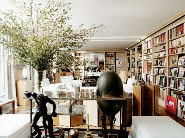 In the library, a cylindrical crystal vase is situated on the François-Xavier Lalanne–designed multi-metal and ovoid Bar YSL. Mondrian's 1920 Composition No. 1 is displayed above a fireplace. Photograph by Pascal Chevallier.