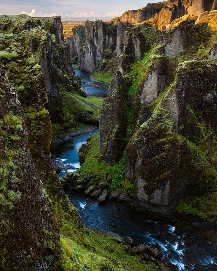 Fjaðrárgljúfur is a canyon in south east Iceland which is up to 100 m deep and about 2 kilometres long, with the Fjaðrá river flowing through it. It is located near the Ring Road, not far from the village of Kirkjubæjarklaustur.