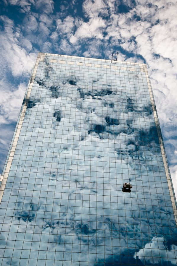 Jakarta, Indonesia......check out the window washers  and beautiful cloud reflections