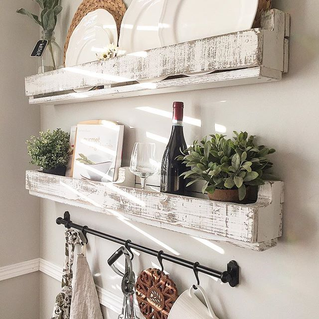 I love this little spot in our kitchen.  We don't have a large kitchen so using our walls for extra storage has always been an easy solution.  We made these shelves ourselves with some old pallets and added this little bar underneath from Ikea recently.  Sharing this for #fridiyday #foilagefridayfreshorfaux #fridayfarmhousefavorites #farmchicfriday #friyaydecorday hosts tagged! . . Would @luciredesign care to share today? . . #farmhouse #pallet #diy #diyhome #kitchen #kitchendesign #storag