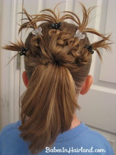 http://babesinhairland.com/hairstyles/knotted-peacocks-tail-hairstyle/