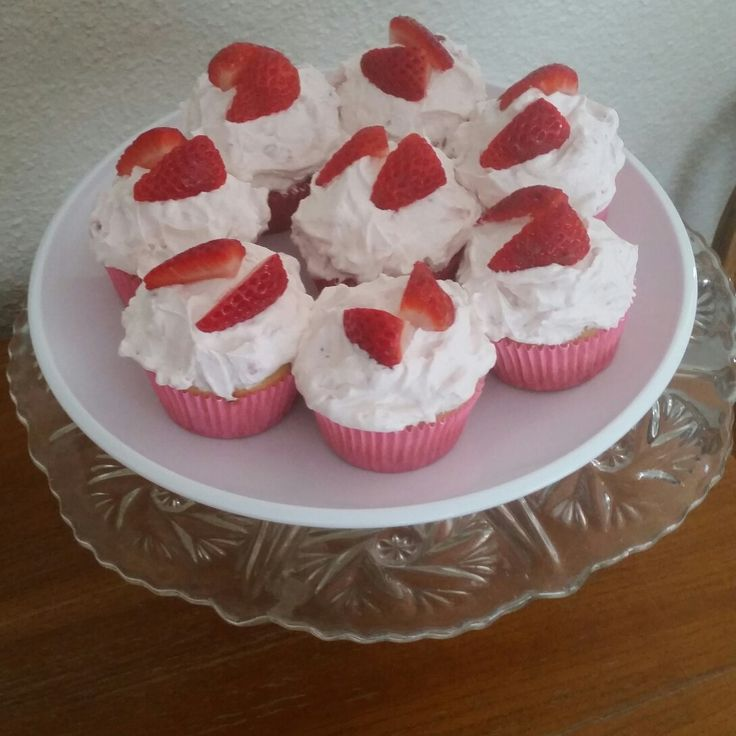 Strawberry shortcake cupcakes with a strawberry jam centre and a strawberry whipped cream topping