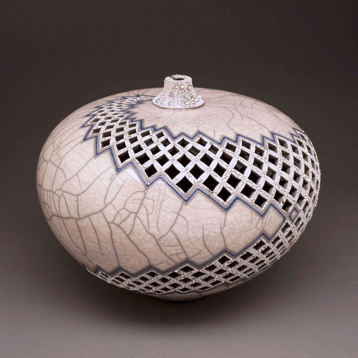 A dramatic bolt of white lightning zags across this raku fired vessel by Eric Stearns from Stearns Ceramic in Lincoln, Nebraska.