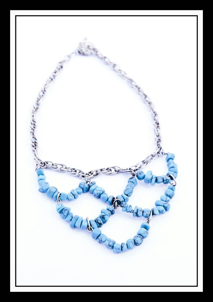 Turquoise beaded necklace with silver chain.  Done