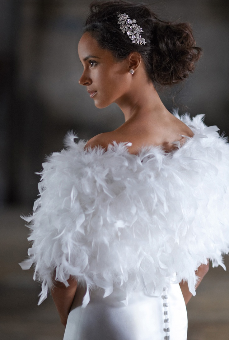 This fun feather wrap is perfect for any true fashionista for Feather wedding dress davids bridal