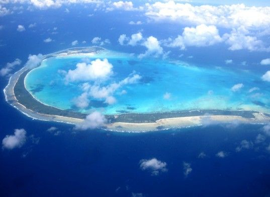 Kiribati, a Pacific island nation, plans to move entire population due to climate change.