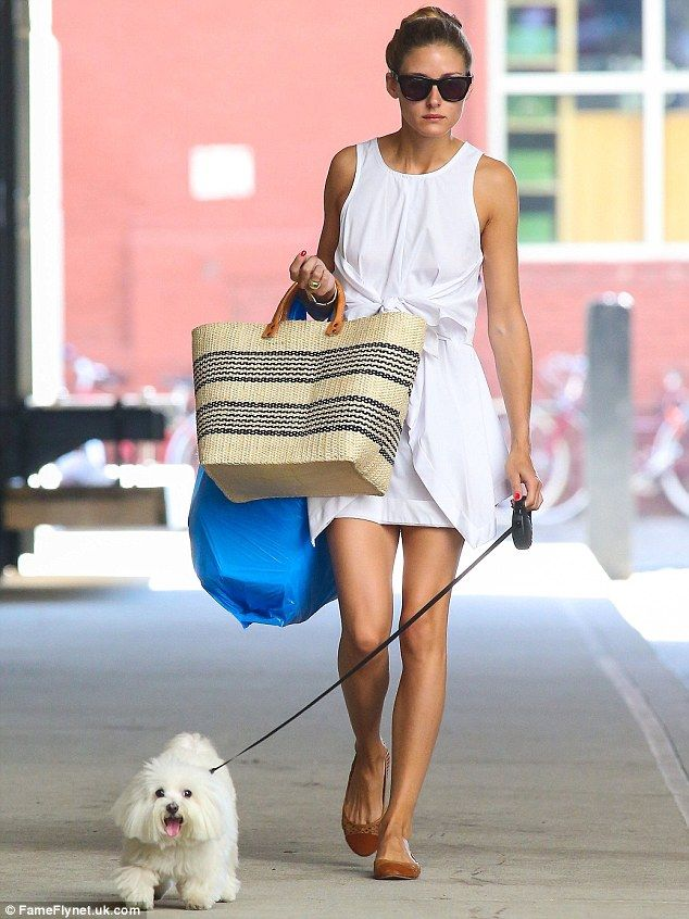 Same dress, different look: Even earlier Olivia was seen walking her little dog, wearing the same chic white frock without the accessories