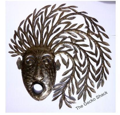 "The Gecko Shack -  ""Mask"" Recycled Oil Drum Haitian Metal Wall Art   63cm, $159.00 (http://www.geckoshack.com.au/mask-recycled-oil-drum-haitian-metal-wall-art-63cm/)"