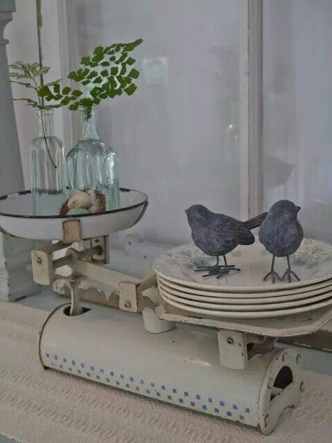 i love how they use a vintage scale to display pretty plates and plants