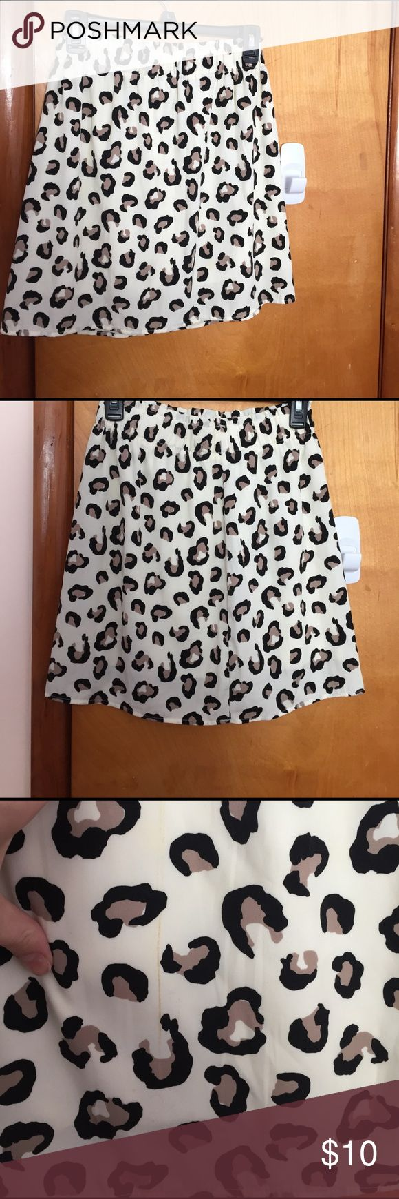 Cheetah skirt Bought this skirt last fall but didn't end up wearing it. Has small discoloration between the pleat on the front but not noticeable at all. It was on clearance when I bought it because of the discoloration. See pics :) Francesca's Collections Skirts Mini