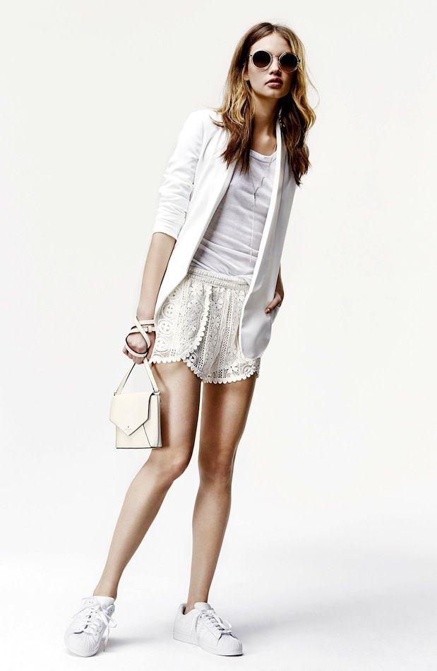 round sunglasses, white blazer, basic tee, lace shorts, mini bag & Adidas sneaker #style #fashion #sporty