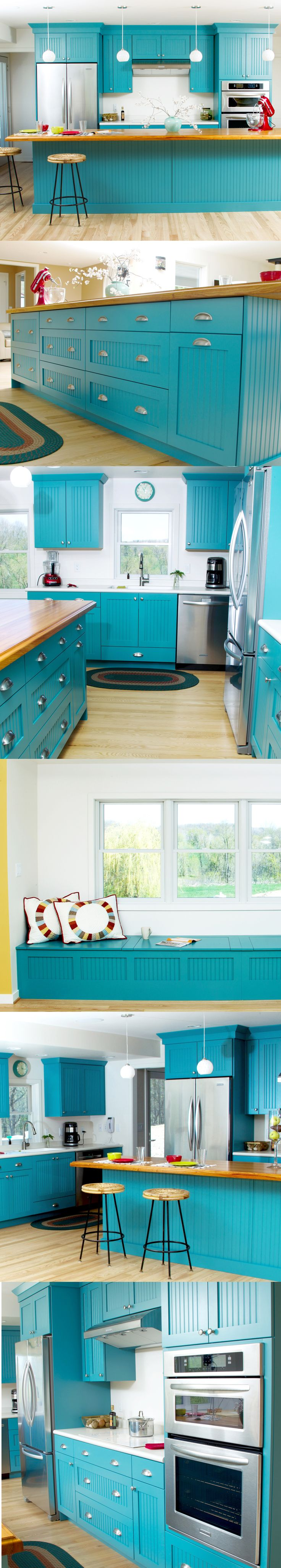 Bright teal transitional cottage styled kitchen featuring red and yellow decor, white and wood countertops, stainless steel and Dura Supreme Cabinetry.