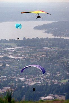 """Paraglide off Tiger Mountain. Or hang glide (which is less common). Either way, this area of the """"Issaquah Alps"""" is the best local place to feel like a bird in flight. That's Lake Samammish in the background."""