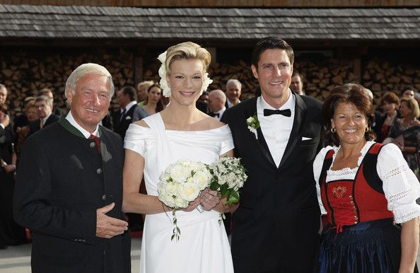 Balthasar Hauser and Magdalena Hauser Photos Photos - (L-R) Balthasar Hauser, owner and director of the Stanglwirt Hotel, Maria Hoefl-Riesch Marcus Hoefl and Magdalena Hauser arrive for the church wedding of Maria Hoefl-Riesch and Marcus Hoefl at Hotel Stanglwirt on April 16, 2011 in Going am Wilden Kaiser, Austria. - Church Wedding Of Maria Hoefl-Riesch & Marcus Hoefl