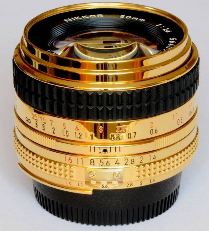 Nikkor 50mm Gold. I don't know if this is real.... but seriously, if it is.... I want it! LOL