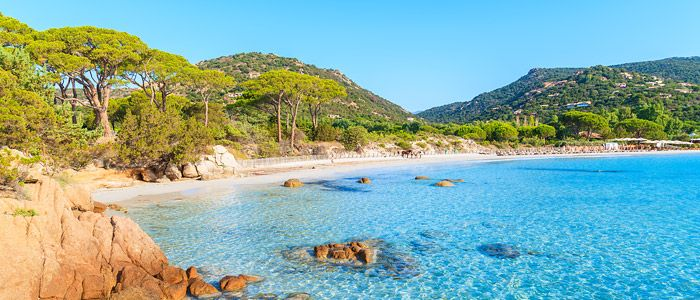 Palombaggia, Corsica - Bathe in shallow, crystalline waters before settling on your lounger for a manicure or a cocktail - Corsica's most famous beach combines Caribbean-esque beauty with the high glamour of St Tropez, while still managing to be child friendly.
