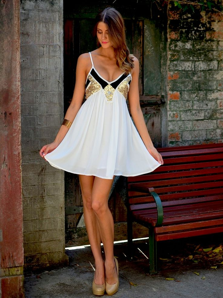 Harlequin Dress at Mura Boutique 2013  Gorgeous gold sequin detailing white dress
