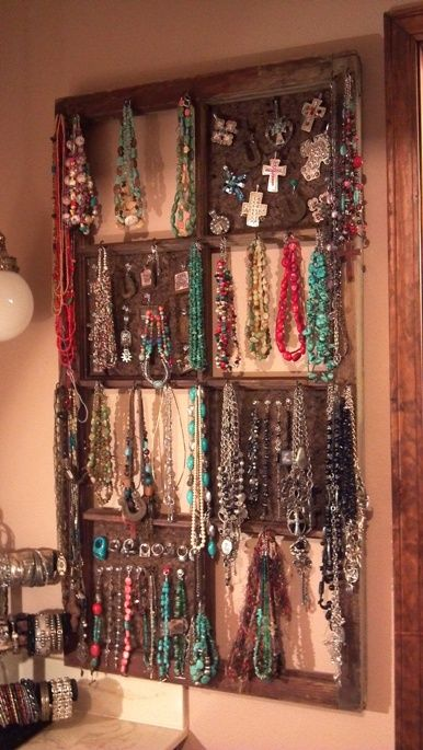 Old window jewelry organizer. Yikes, someone with as much jewelry as me.