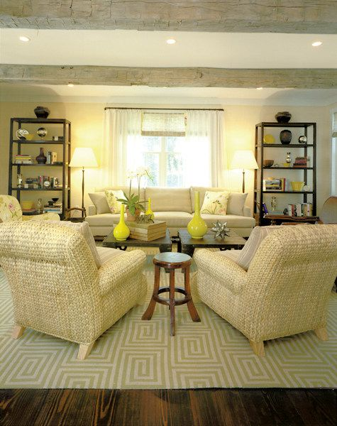 thom filicia neutral sitting area with electric yellow statement pieces